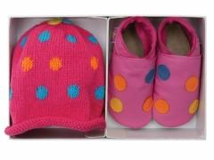 Dotty pink soft leather baby shoes with matching cotton hat in a luxury gift box