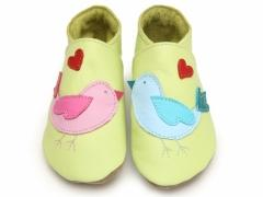 lovebirds baby shoes on lemon