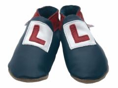 Red and white Learner plates on soft leather navy baby shoes.