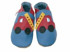 Red Fire Engines with yellow ladders and shiny blue window and lights on blue soft leather kids shoes.