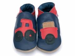 Red tractor and trailer on navy soft leather baby shoes.