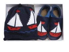 Sailboat navy soft leather baby shoes with matching cotton hat in a luxury gift box