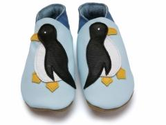 Soft leather baby shoes, black and white penguin design with yellow beak and feet on baby blue shoes.