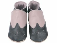 Soft leather baby shoes, classic chocolate brogue punched and sculpted toe cap and collar, on taupe shoes.