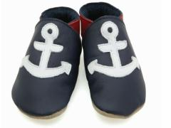 Soft leather baby shoes, classic sailors anchor design in white on navy shoes.