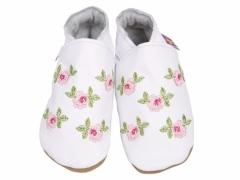 Soft leather baby shoes, embroided pink roses with green petals design on white shoes.