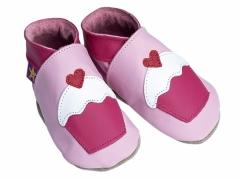 Soft leather baby shoes, Fairycake design with white icing on baby pink shoes.