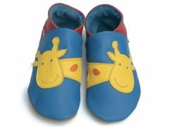 soft leather baby shoes in blue with bright yellow giraffe design.