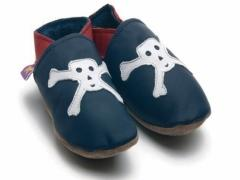 Soft leather baby shoes, Jolly Roger skull and cross bones design in white on navy shoes.