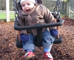 Joshua swinging with patch red shoes